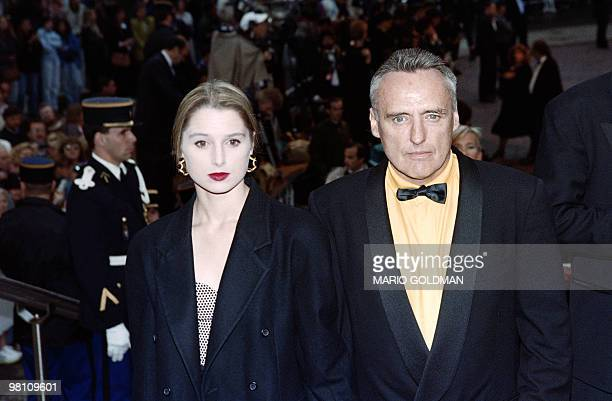 "Actor and fim director Dennis Hopper arrives at the Palais des Festivals flanked by his wife Katherine to attend the screening of the movie ""Jungle..."