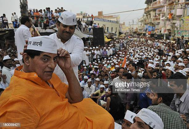 Actor and former athlete Praveen Kumar joined the Aam Admi Party of Arvind Kejriwal during a rally at Sonia Vihar on September 8 2013 in New Delhi...