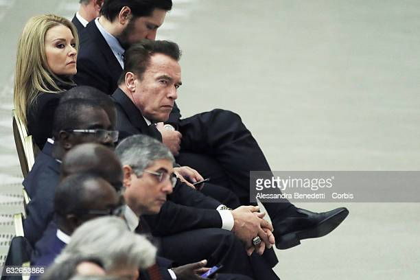 US actor and former governor of California Arnold Schwarzenegger and his girlfriend Heather Milligan attend the Pope's weekly general audience at the...