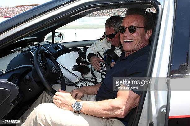 Actor and former governor of California Arnold Schwarzenegger poses for a photo before driving the 2016 Toyota Mirai pace car a hydrogen fuelcell...