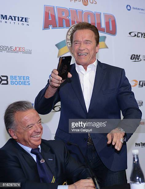 Actor and former Governor of California Arnold Schwarzenegger smiles after taking a selfie at the Arnold Classic Sports Festival Press Conference on...