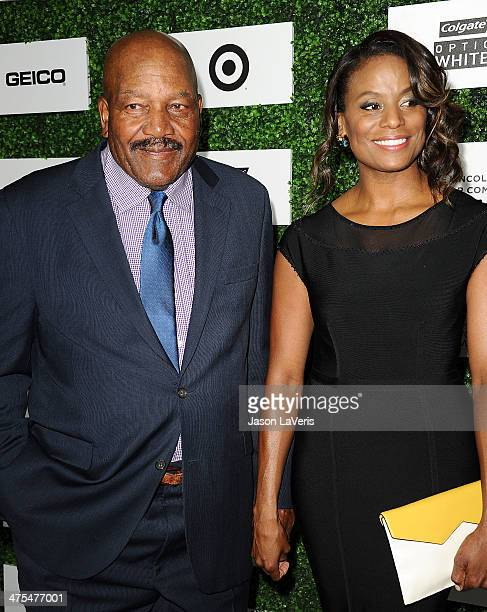 Actor and former NFL player Jim Brown and wife Monique Brown attend the 7th annual ESSENCE Black Women In Hollywood luncheon at Beverly Hills Hotel...