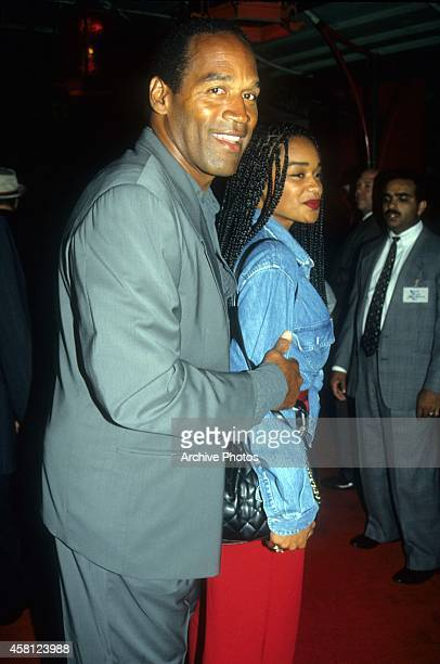 Actor and former NFL player OJ Simpson and daughter Arnelle arrive for the Cliffhanger premiere on May 26 1993 at the Mann's Chinese Theatre in...
