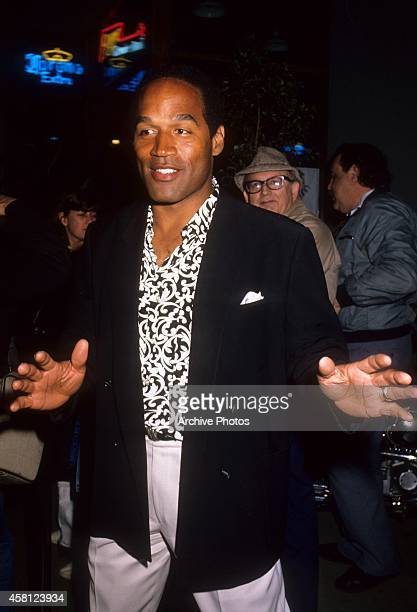 Actor and former NFL player OJ Simpson arrives at a movie premiere circa 1990 in Los Angeles California