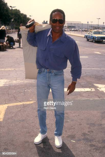 Actor and former NFL star OJ Simpson poses for a portrait with sunglasses circa 1992 in Los Angeles California