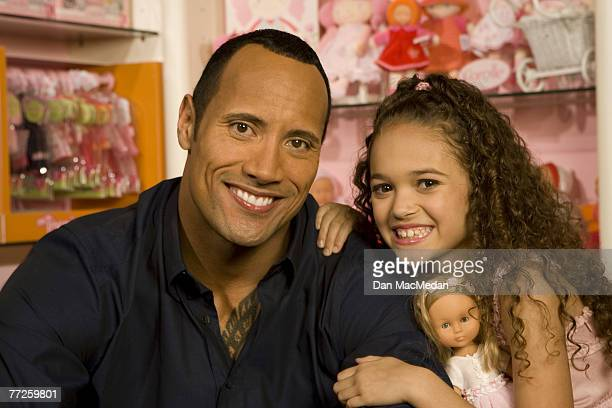 Actor and former pro wrestler Dwayne The Rock Johnson and actress Madison Petis pose at a portrait session at the Toyology toy showroom in Los...