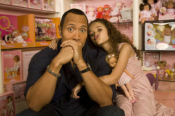 Actor and former pro wrestler Dwayne 'The Rock' Johnson and actress Madison Petis pose at a portrait session at the Toyology toy showroom in Los...