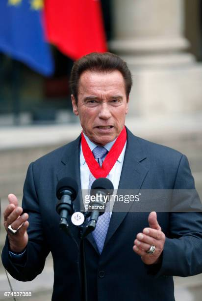 Actor and former US Governor of California Arnold Schwarzenegger makes a statement after receiving his 'Chevalier de la Legion d'Honneur' medal by...
