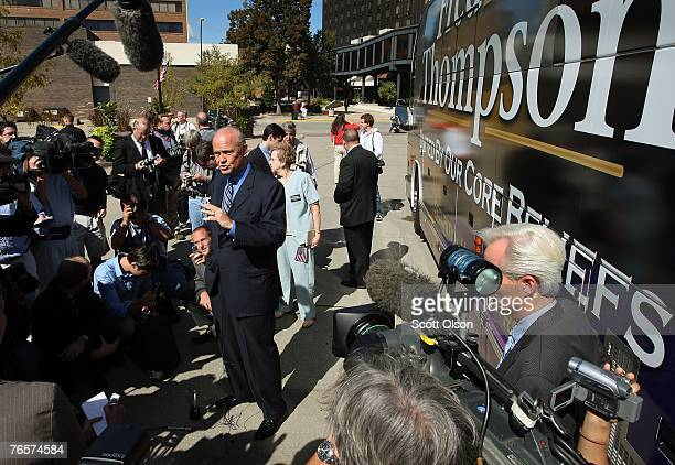 Actor and former US Senator Fred Thompson speaks outside his campaign bus following a stop September 7 2007 in Sioux City Iowa This is Thompson's...
