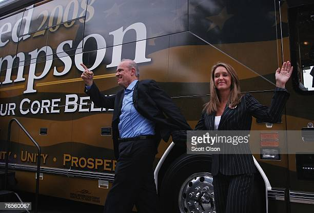 Actor and former US Senator Fred Thompson waves to a crowd of people as he steps off his bus with his wife Jeri during a campaign stop September 6...
