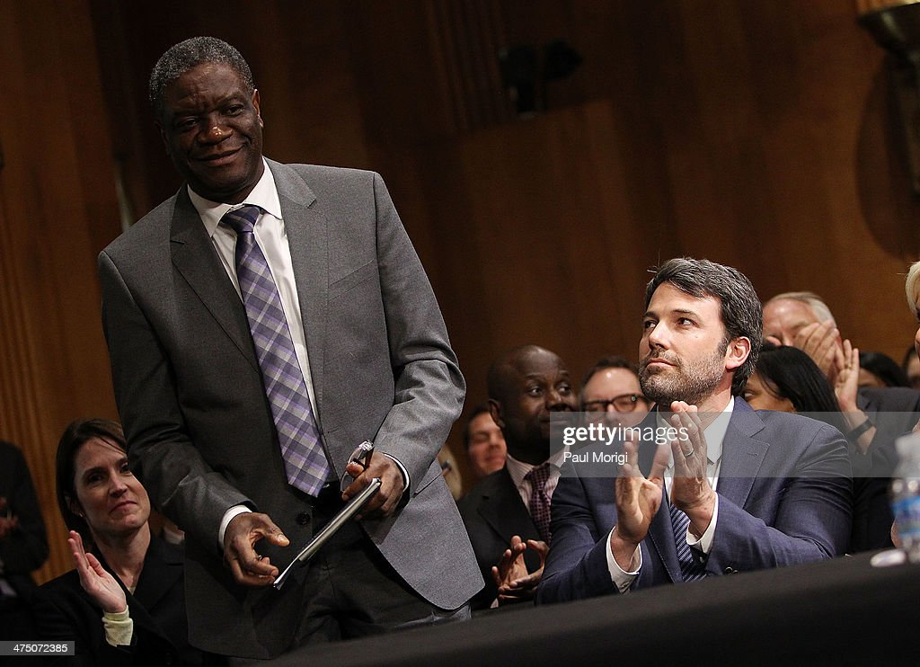 Actor and founder of the Eastern Congo Initiative Ben Affleck (R) applauds the recognition of pioneering doctor Denis Mukwege (L) at the US Senate Hearing On The Democratic Republic Of Congo at Dirksen Senate Office Building on February 26, 2014 in Washington, DC. The committee was hearing testimony on prospects for peace in the Democratic Republic of Congo and Great Lakes Region.
