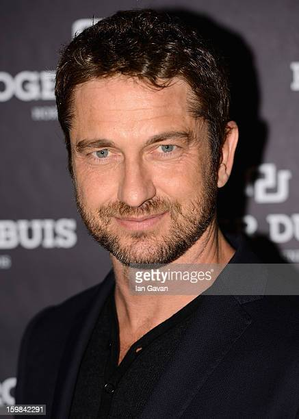 Actor and friend of the Roger Dubuis brand Gerard Butler poses as he visits the Roger Dubuis booth during the 23rd Salon International de la Haute...