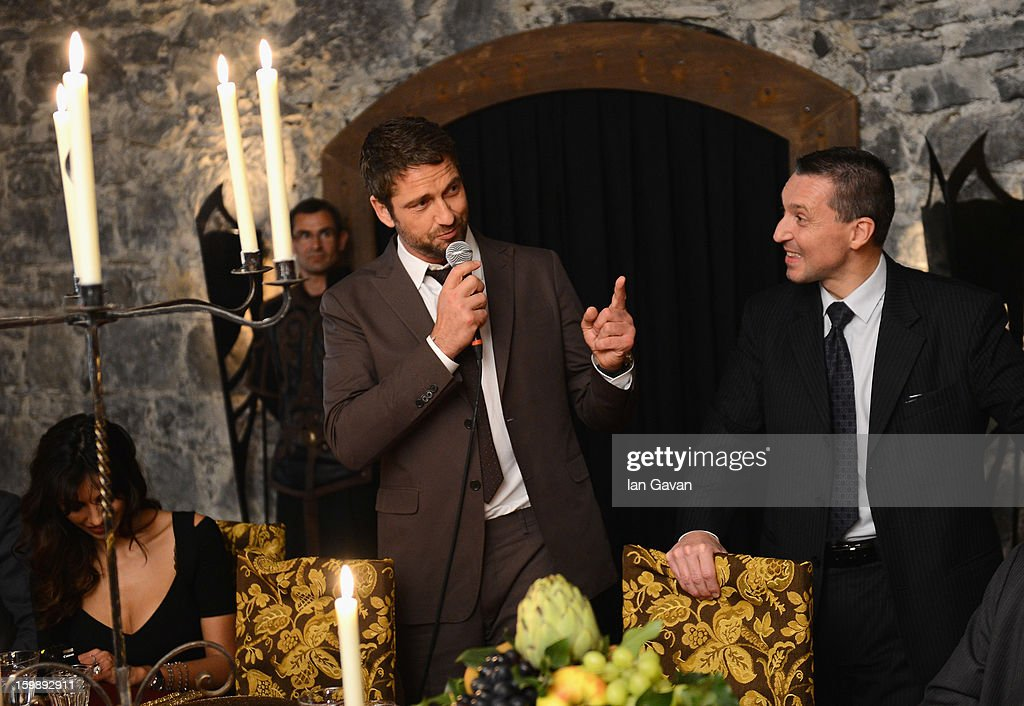 Actor and friend of the Roger Dubuis brand Gerard Butler talks with CEO Jean-Marc Pontroue (R) during the Excalibur Dinner at the 23rd Salon International de la Haute Horlogerie at Caves des Vollandes on January 21, 2013 in Geneva, Switzerland.