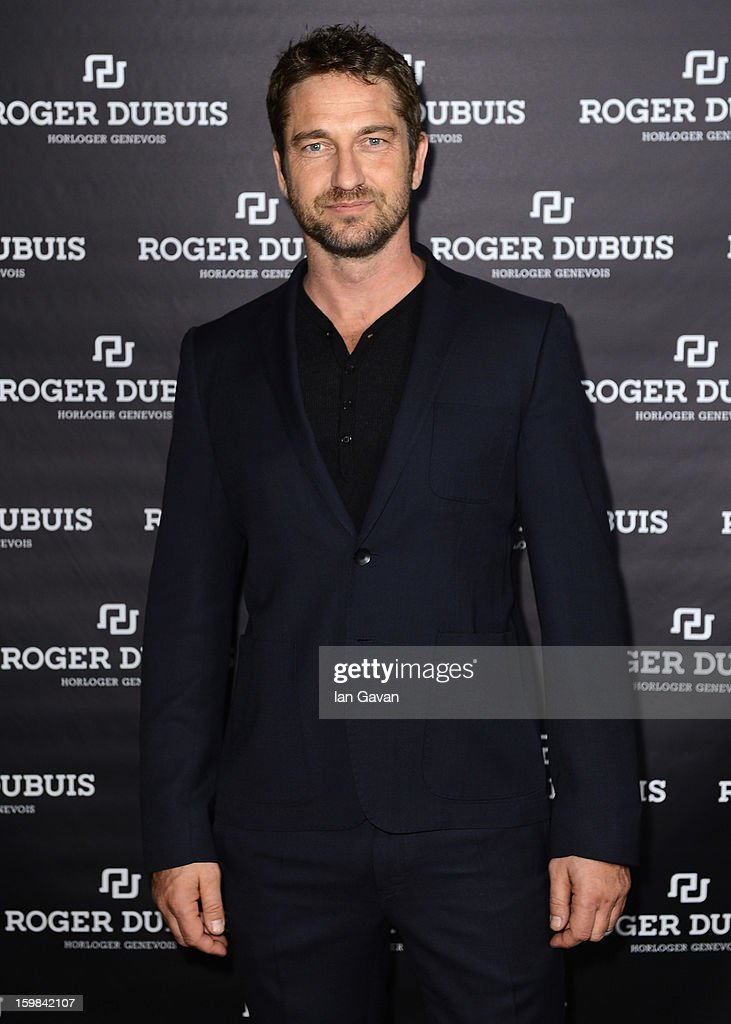 Actor and friend of the Roger Dubuis brand Gerard Butler visits the booth during the 23rd Salon International de la Haute Horlogerie at the Geneva Palexpo on January 21, 2013 in Geneva, Switzerland.