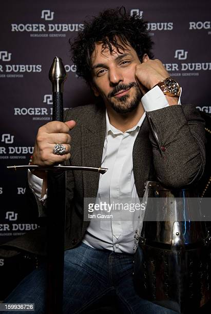 Actor and friend of the Roger Dubuis brand Tomer Sisley poses with a sword and a knight's helmet in the booth during the 23rd Salon International de...