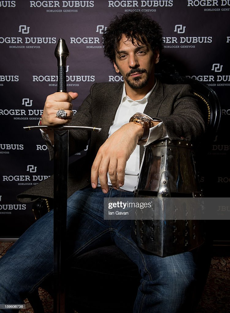 Actor and friend of the Roger Dubuis brand, Tomer Sisley poses with a sword and a knight's helmet in the booth during the 23rd Salon International de la Haute Horlogerie at the Geneva Palexpo on January 23, 2013 in Geneva, Switzerland.