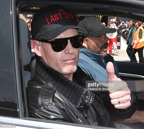 Actor and Grand Marshall of the Auto Club 400 NASCAR Sprint Cup Series Event Weekend Eric Dane gives a thumbs up at the Auto Club Speedway on March...