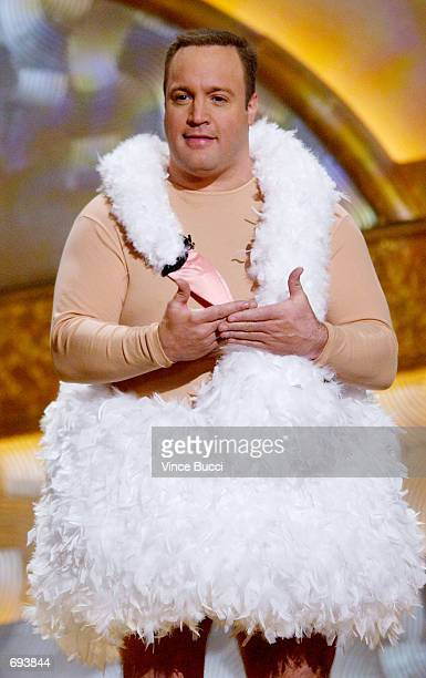 Actor and host Kevin James wears a swan dress on stage during the 28th Annual Peoples Choice Awards at the Pasadena Civic Center January 13 2002 in...