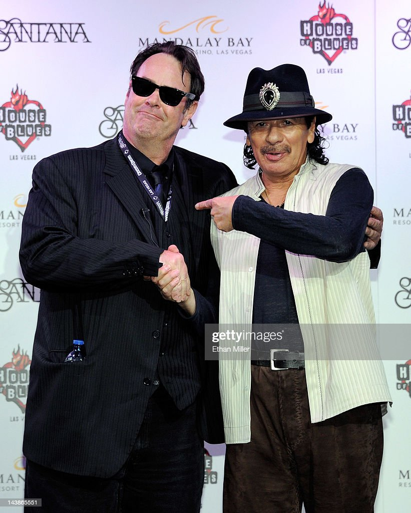 Actor and House of Blues co-founder Dan Aykroyd (L) and recording artist Carlos Santana appear at the House of Blues inside the Mandalay Bay Resort & Casino during a mud ceremony May 4, 2012 in Las Vegas, Nevada. The ceremony involved combining dirt from the town of Clarksdale in the Mississippi Delta with dirt from Bethel, New York from the site of the Woodstock Festival and mud from Santana's hometown of Autlan de Navarro, Jalisco in Mexico to symbolize his two-year residency at the music venue.