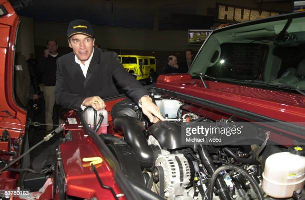 Actor and Hummer patron Arnold Schwarzenegger pauses to check out the 2003 Hummer H2 at the Los Angeles Auto Show Friday, Jan. 4, 2002 at the Los...