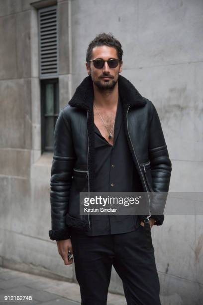 Actor and Made in Chelsea star Hugo Taylor wears a Blood Brother jacket Maximillian London shirt day 3 of London Mens Fashion Week Autumn/Winter 2018...