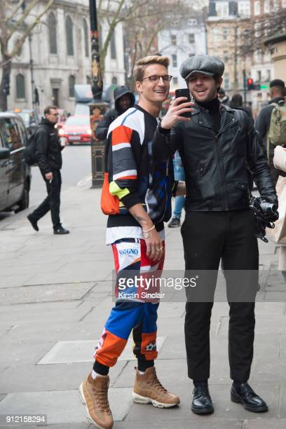 Actor and Made in Chelsea star Oliver Proudlock wears a Ksenia Schnaider tracksuit and Nike trainers with a guest day 3 of London Mens Fashion Week...