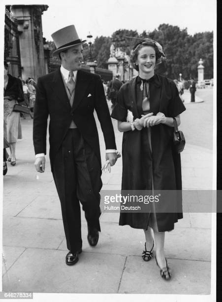 Actor and manager Brian Rix and his wife actress Elspet Gray arrive at Buckingham Palace for the Royal Garden Party 1952