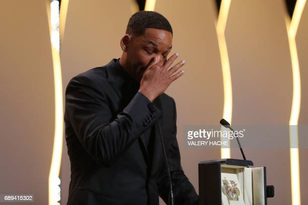 US actor and member of the Feature Film jury Will Smith accepts on May 28 2017 the 70th edition Special Prize on behalf of Australian actress Nicole...