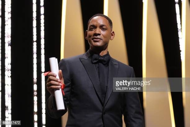 US actor and member of the Feature Film jury Will Smith poses on stage on May 28 2017 after he accepted the 70th edition Special Prize on behalf of...