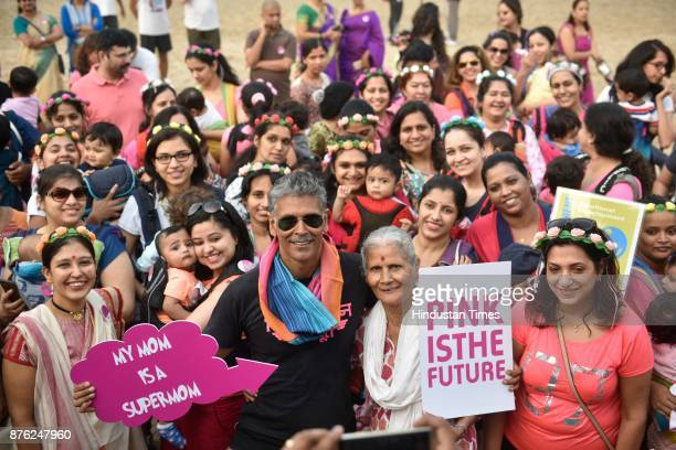 Actor and model Milind Soman and Women with their babies participate in BabyWearing Super Moms event organised by by Colors Pinkathon at Juhu Beach...