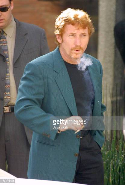 Actor and morning DJ Danny Bonaduce smokes a cigarette outside the Ivy restaurant March 21 2001 in Beverly Hills CA Bonaduce will be one of the many...