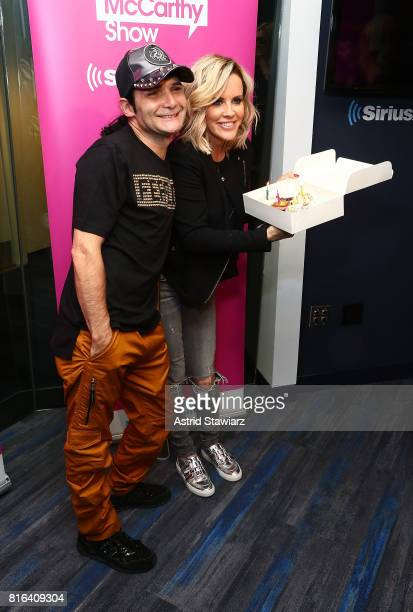 Actor and musician Corey Feldman poses for photos with SiriusXM host Jenny McCarthy during 'The Jenny McCarthy Show' at the SiriusXM Studios on July...