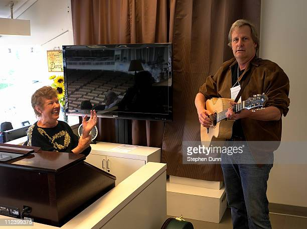 Actor and musician Jeff Daniels rehearses for his performance of the national anthem with Dodger Stadium organist Nancy Bea Hefley in the press box...