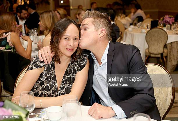 Actor and musician Mark McGrath and wife Carin McGrath await to be honored during the Path2Parenthood - Illuminations LA 2015 celebrations at the...