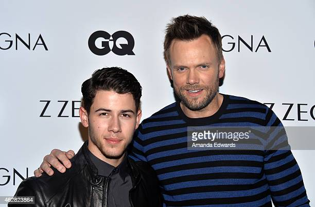 Actor and musician Nick Jonas and comedian Joel McHale attend the Z Zegna GQ celebration of the new Z Zegna hosted by Nick Jonas at Philymack Inc on...