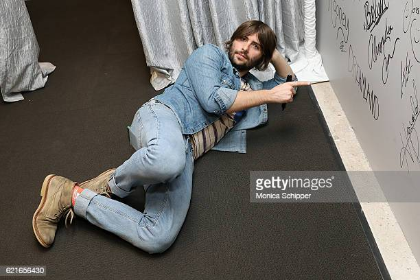 Actor and musician Robert Schwartzman signs the wall at AOL HQ when he visits for The Build Series Presents Robert Schwartzman Discussing The New...