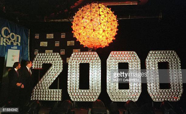 Actor and NYC 2000 Chairman Ron Silver and Con Edison President and CEO Eugene McGrath watch as the New Year's Eve Ball and 2000 numerals run through...