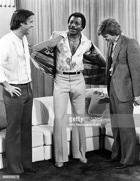 Actor and performer Carl Weathers on stage with two people Baltimore Maryland 1978