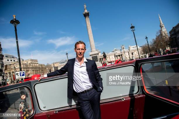 Actor and political activist, Laurence Fox, poses for photographs on top a double decker bus near Trafalgar Square as he launches his bid to become...