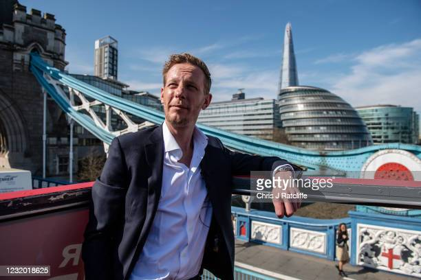 Actor and political activist, Laurence Fox, poses for photographs on top a double decker with City Hall in the background as he launches his bid to...