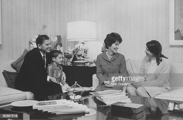 Actor and politico Ronald W Reagan sitting at home with wife and two children