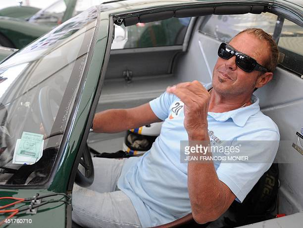 US actor and producer Chad McQueen son of US actor Steve McQueen poses while sitting in a 1966 Porsche 906 in a paddock of the Le Mans circuit on...