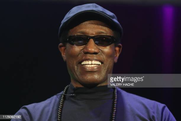 US actor and producer Wesley Snipes smiles during a conference at the MAGIC on March 9 2019 in Monaco