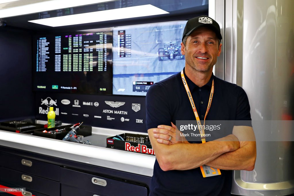 Actor And Racing Driver Patrick Dempsey Looks On From The Red Bull