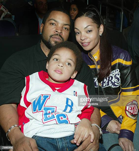 Actor and rap artist Ice Cube wife Kim and their son pose before the 2004 NBA AllStar Game held at the Staples Center February 15 2004 in Los Angeles...