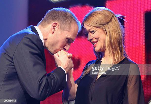 Actor and Shooting Star patron Ralph Fiennes kisses the hand of actress Heike Makatsch on stage during the Shooting Star Awards 2011 on day five of...