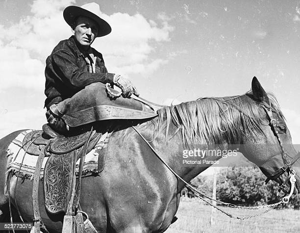 Actor and singer Bing Crosby riding his favorite horse on his family ranch in Elko Nevada circa 1950