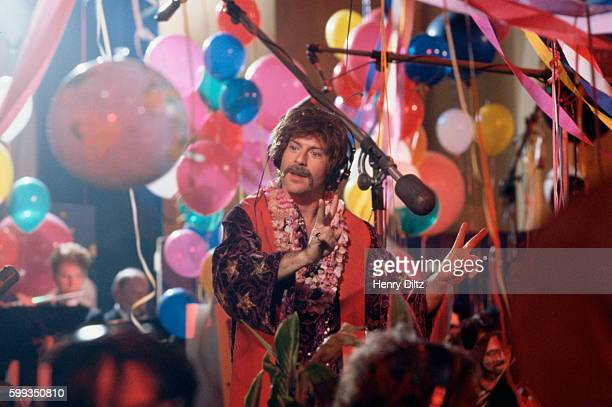Actor and singer Bruce Willis acts in a skit imitating the Beatles in Sgt Pepper's Lonely Hearts Club Band during the filming of a TV special called...