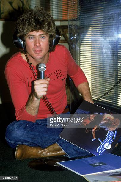 Actor and singer David Hasselhoff at his home in Hollywood singing along to a Ted Nugent record 1979
