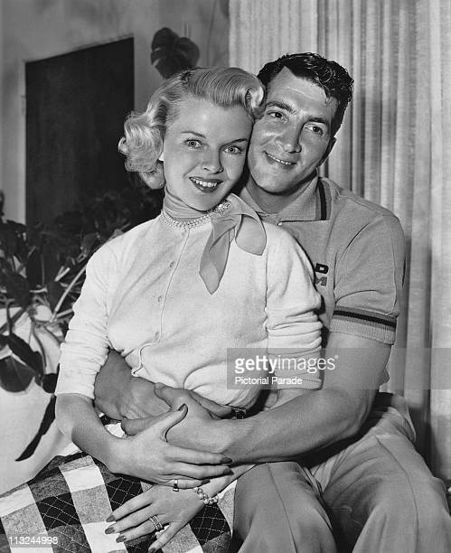 Actor and singer Dean Martin at home with his wife Jeanne Biegger between shoots for his film 'Jumping Jacks' in 1952
